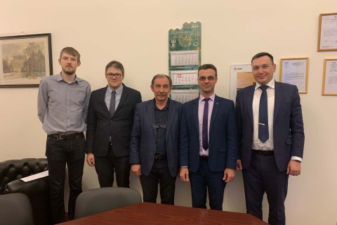 """Meeting of center specialists with the developer of optimization technology IOSO I. N. Egorov - in the center on the photo. Also on the photo: project Manager of the center A. A. Aksenov, Deputy head of the CVRE Department for scientific work of A. M. Danilishin, head of """"Compressor, vacuum and refrigeration engineering"""" Department - acting Director of IETS Yu. V. Kozhukhov, Deputy head of OKB by the name of Lyulki S. A. Vaculin."""