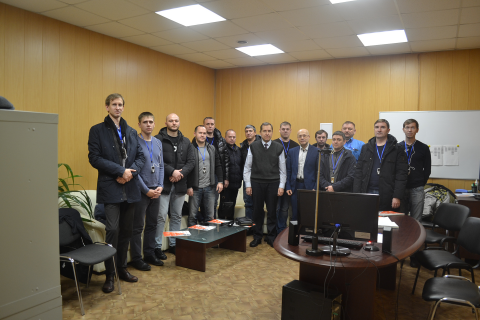 """Visit of a group of students from Gazpromneft Khantos, Gazpromneft Yamal, Gazpromneft Orenburg, Gazpromneft Vostok and Messoyakhaneftegaz in the framework of the training course of the center """"Compressor, vacuum, compressor equipment and pneumatic systems"""" to the Arsenal machine building plant. At the photo, a group of students with the Director of the center Sergey Kartashev and and the Director of the Arsenal machine building plant K. V. Chernitsky"""