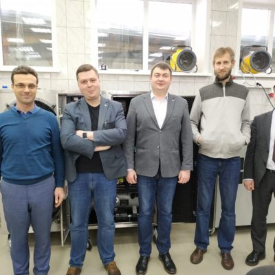 "Participants of the 10th international scientific and technical conference ""Technique and technology of petrochemical and oil and gas production 2020"" in the laboratory of refrigeration equipment of Omsk State Technical University. From left to right: Scientific Director of the Research Center ""Compressor, Vacuum, Refrigeration and Pneumatic Systems"" Yu.V. Kozhukhov, assistant OmSTU V.S. Evdokimov, assistant OmSTU A.V. Tretyakov, director of SIC ""Compressor, vacuum, refrigeration equipment and pneumatic systems"" S.V. Kartashov, head of the design department of JSC Compressor A.V. Burakov"