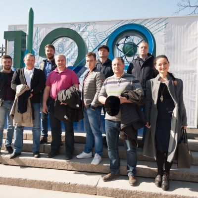 "A group of the advanced training course on the topic ""Acceptance tests of compressor equipment by the customer ""from OOO "" Gazprom 335"", AO ""Vostochno-sibirskaya neftyanaya kompaniya"", OAO ""TomskNIPI Neft"", OOO ""Gazprom transgaz Surgut"" at a tour around Peter the Great St. Petersburg Polytechnic University."