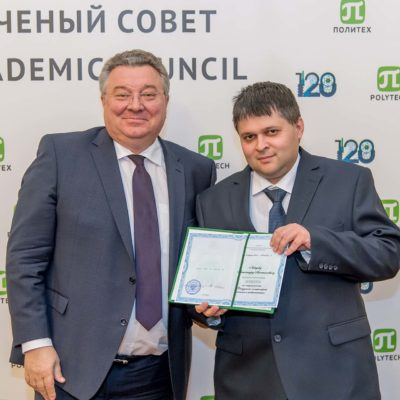 Presentation of the certificate of assignment of the title of associate professor to the director of the Higher School of Power Engineering Engineering SPbPU A.A. Lebedev. The certificate is presented by the rector of SPbPU A.I. Rudskoy