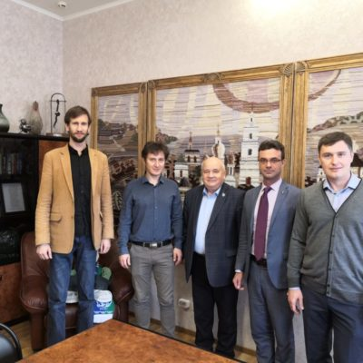 "Meeting of the Director of the Scientific and Engineering Center ""Compressor, Vacuum, Refrigeration and Pneumatic Systems"" S.V. Kartashov and the science supervisor of the center Yu.V. Kozhukhov with the President of Nizhnevartovsk State University A.K. Karpov (pictured in the center)"